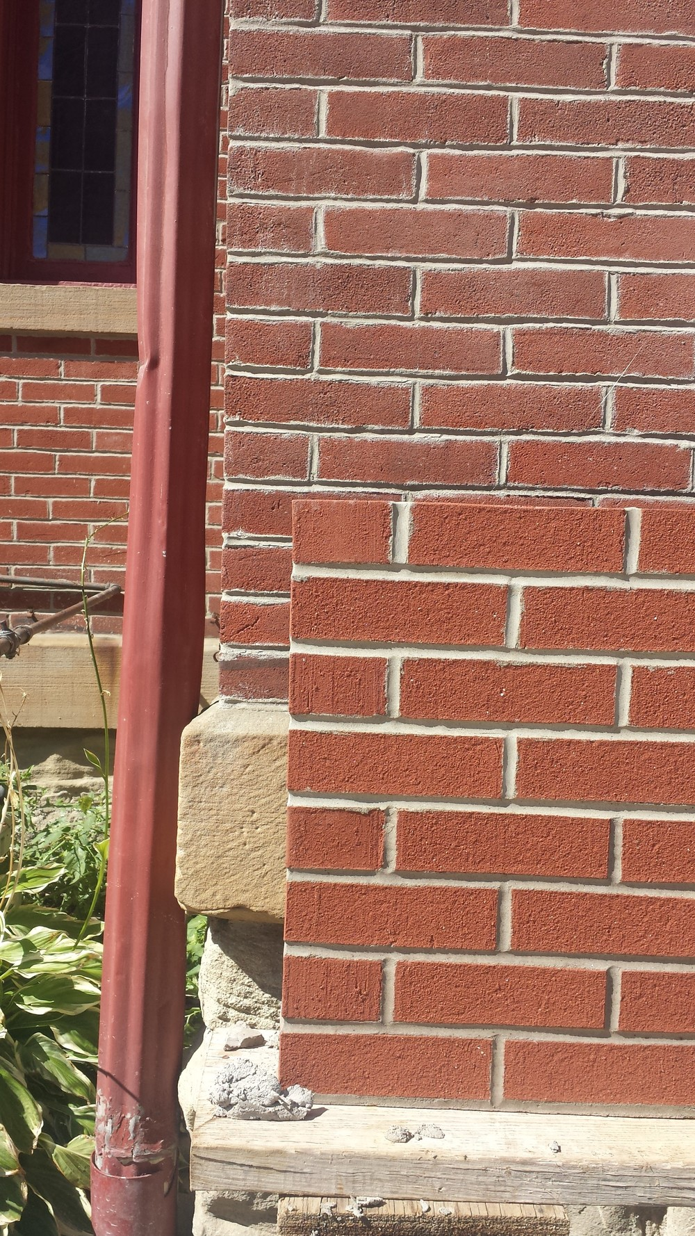 Matching new brick with the 100+-year-old brick on the existing building.