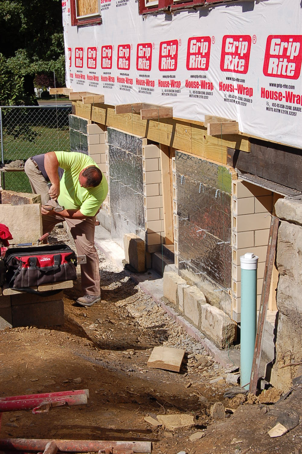 Stone work begins 9/21/15. Stone is cut to give it an aged look and to help blend in with the existing structure.