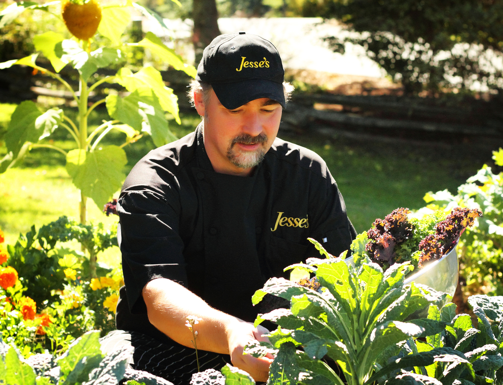 Chef Coulter harvests kale grown on the property for a special salad.