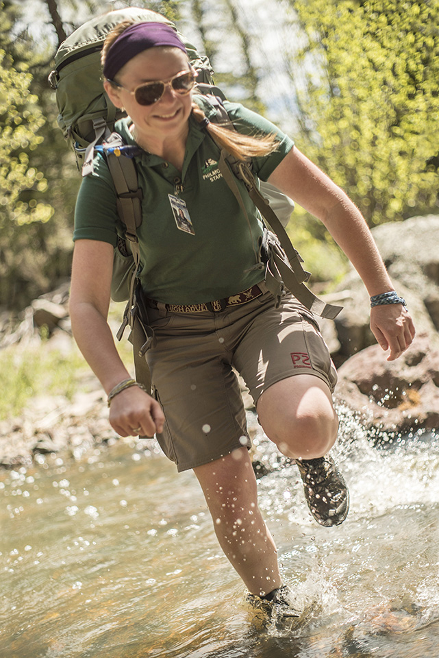 Ranger Trainer Tori Mack gets her boots wet while crossing a stream.