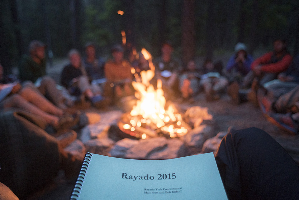 Rayado rangers gather around a campfire during Rayado training.