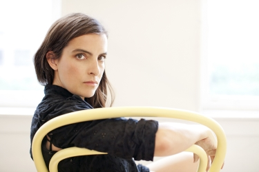Born outside of Hartford, Connecticut, Rachel Comey attended the University of Vermont as an art major.  After college, Comey moved to New York City to further pursue opportunities in the arts. Her earliest efforts in fashion came as costume designer for bands in the downtown music scene, earning her a place in the 2001 Whitney Biennial. Her collections are known for artful custom textiles, graceful modern silhouettes, and covetable footwear. The brand appeals to the intelligence and independence of her customers, who appreciate locally produced garments, thoughtful hand crafted details and an offbeat charm. All woven garments are made in Manhattan, while knitwear and footwear is made in Peru.  The collection is stocked in many of the world's finest boutiques and department stores.  Comey  splits her time between NYC and her converted- laundromat home on Long Island's North Fork. {Press courtesy of Rachel Comey}