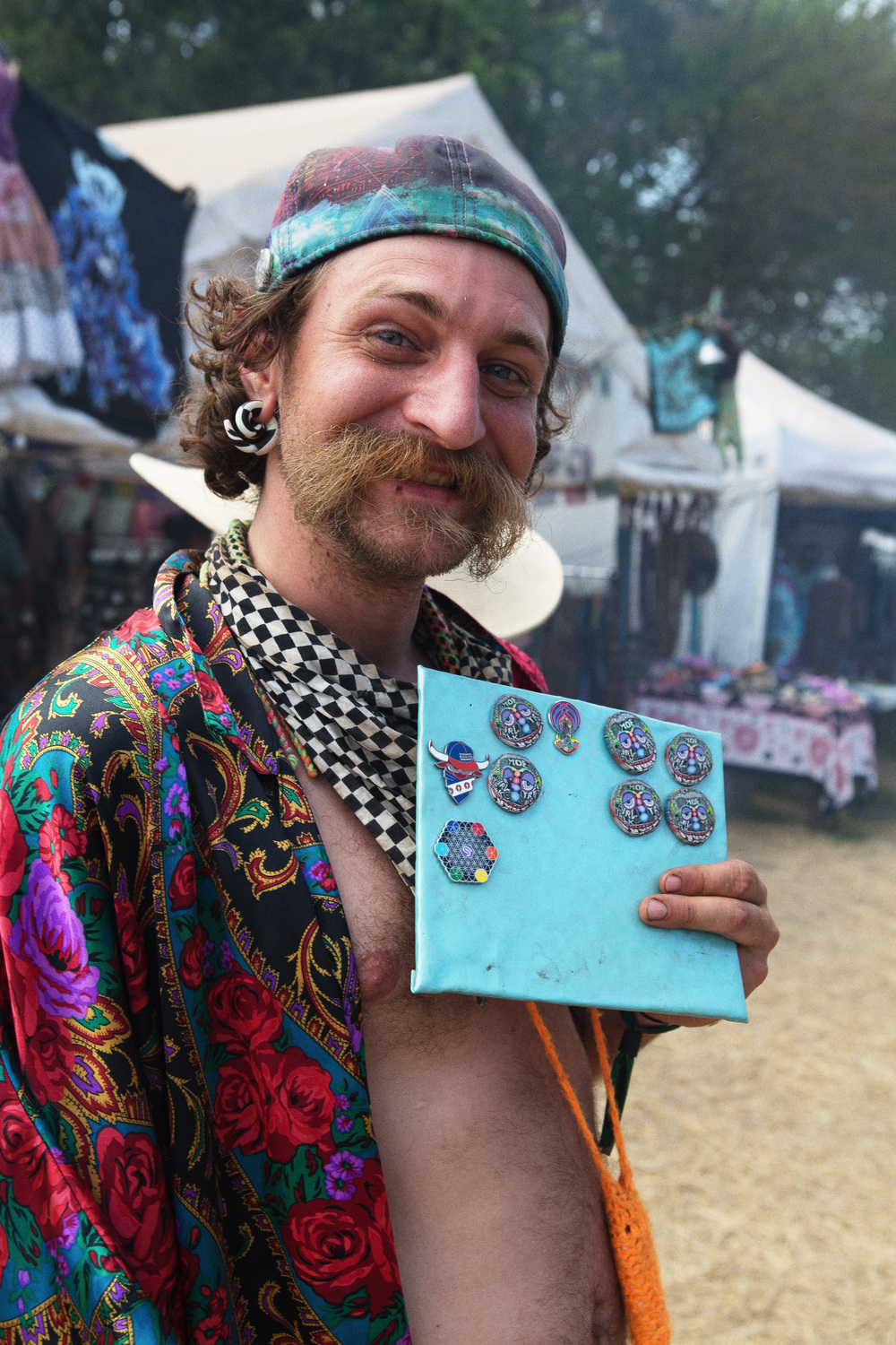 Pins are In    Walking around the festival, there were a lot of people trading pins. I couldn't help but ask this gentlemen and his mustache for a picture.