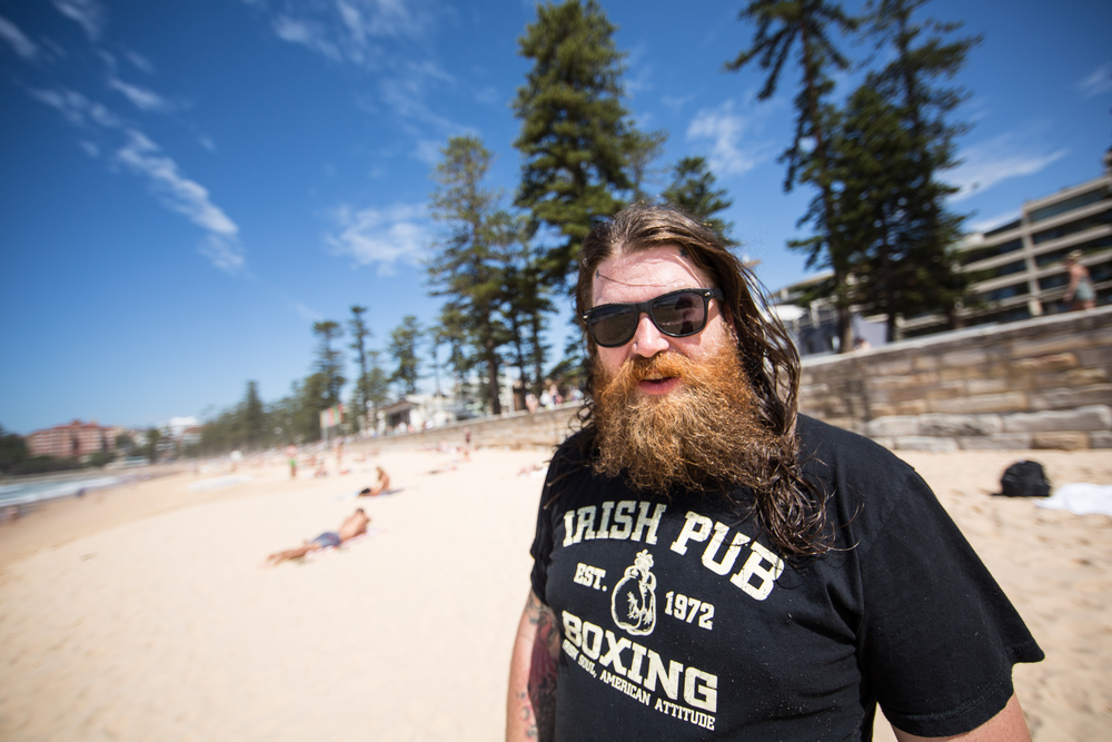 """Find the Roadie"" Nothing screams American on Tour than a hairy man with an Irish Pub Boxing shirt on a beach more than Josh Bennett. Did I mention we were listening to Hendrix as loud as we could over the hairless EDM'ers.  Sydney, AU (Manly Beach here) is my favorite city in the world, if you're asking."