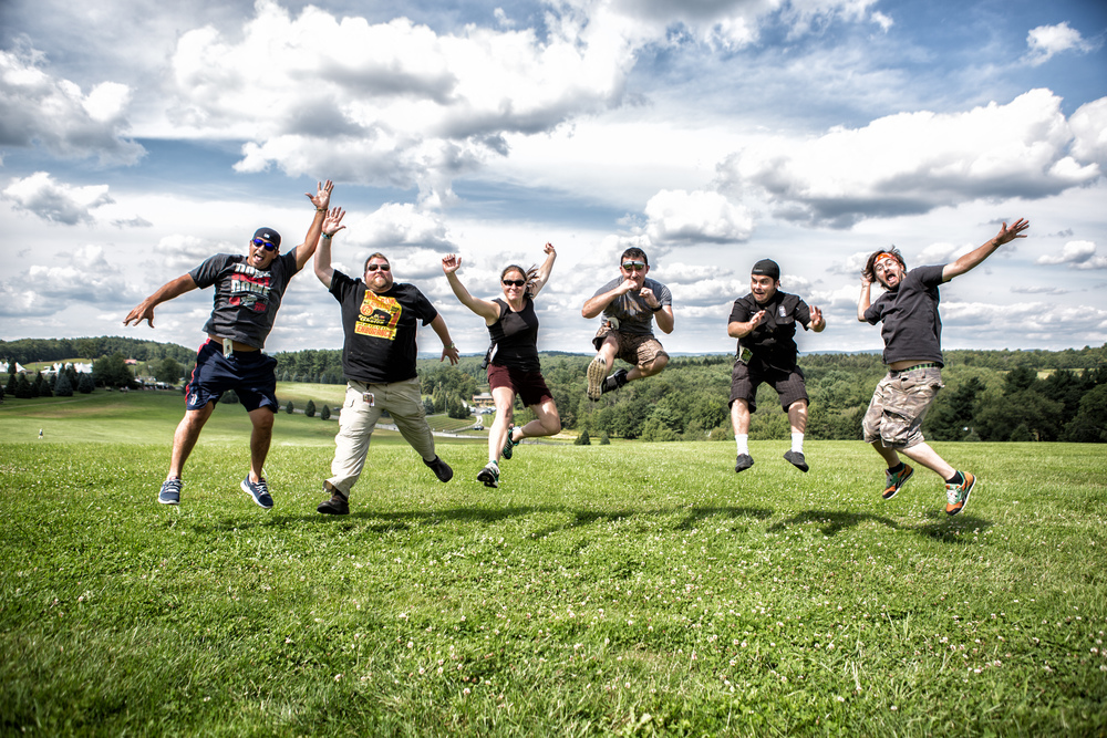 Don't Eat The Brown Acid, Unless It's Cooked By A Chef Ok, Ok, so jumping pictures are nothing new. But let's be honest, nothing helps shows how epic a moment is than everyone jumping in unison. Plus, come on, those clouds are badass.  Oh yeah, did I mention this jump was @ the original site of Woodstock in Bethel Woods, NYC? Points for context. Shutter Speed @1/400 *Disclaimer-Don't eat acid and blame it on me, dude.