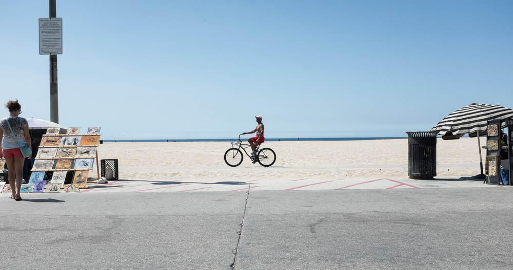 Enjoying a day off in Santa Monica, I rented a bike, grabbed the Fuji x100s, and made my way towards Venice Beach. It's always intriguing when you go somewhere for the first time and it feels like home.  Venice Beach Boardwalk, I'll be back home one day....