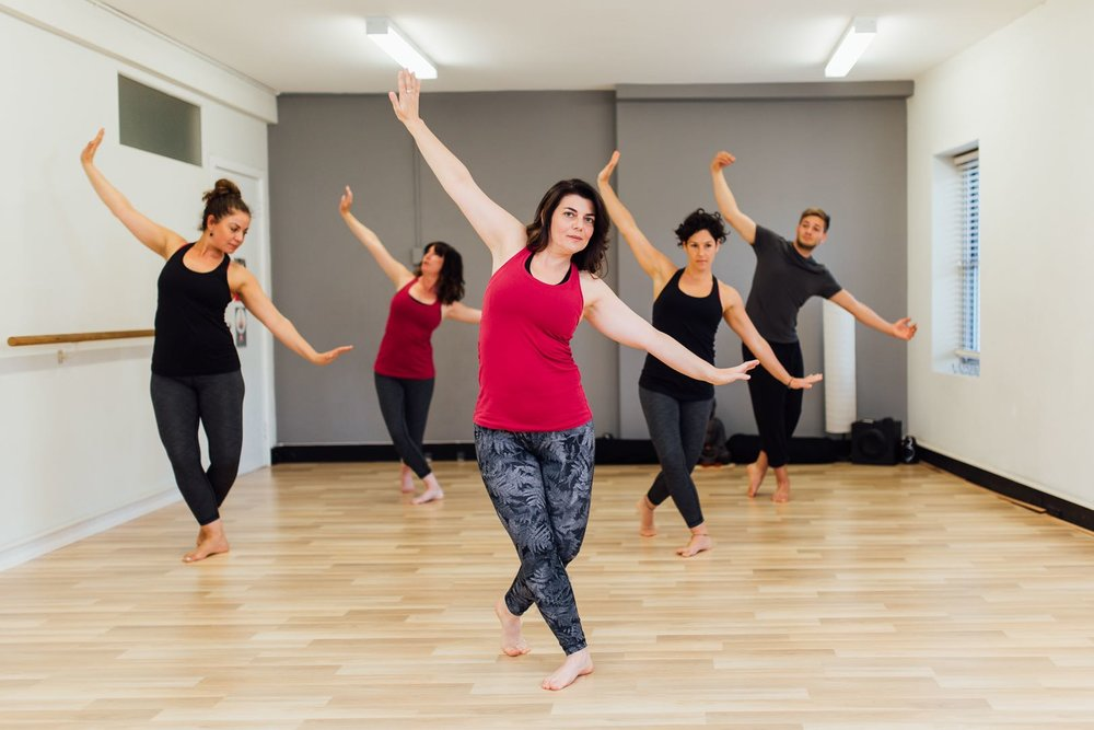 Carly Landa, founder leads a dance class