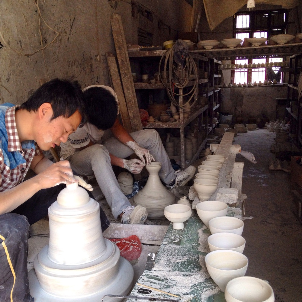This is a throwing studio where the thrower and turner work side by side. If you take a pot thrown by someone other then the turners partner he will not know how to turn it. They are trained together over 3 years where the first year consists of wedging clay and cleaning the studio.