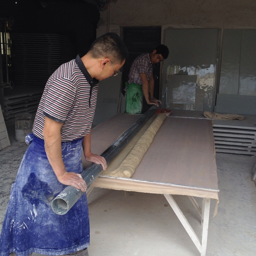 A large tile workshop. It was very impressive to see two men roll out a tile over 2meters wide in what would be the size of a standard single car garage.