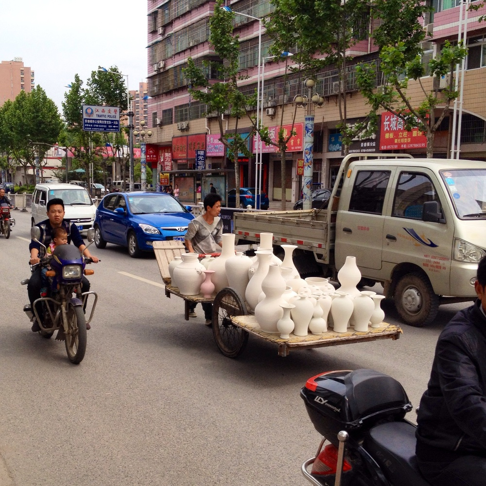 I could not imagine any other place on earth where it would be a common site to see a cart loaded with porcelain being wheeled through the traffic!