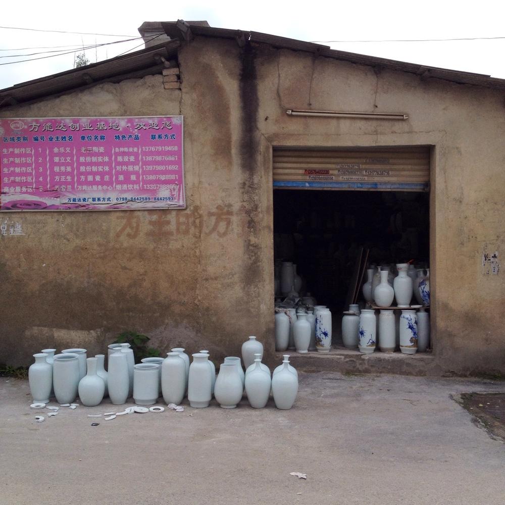 A little shop selling glazed porcelain vases for decoration.