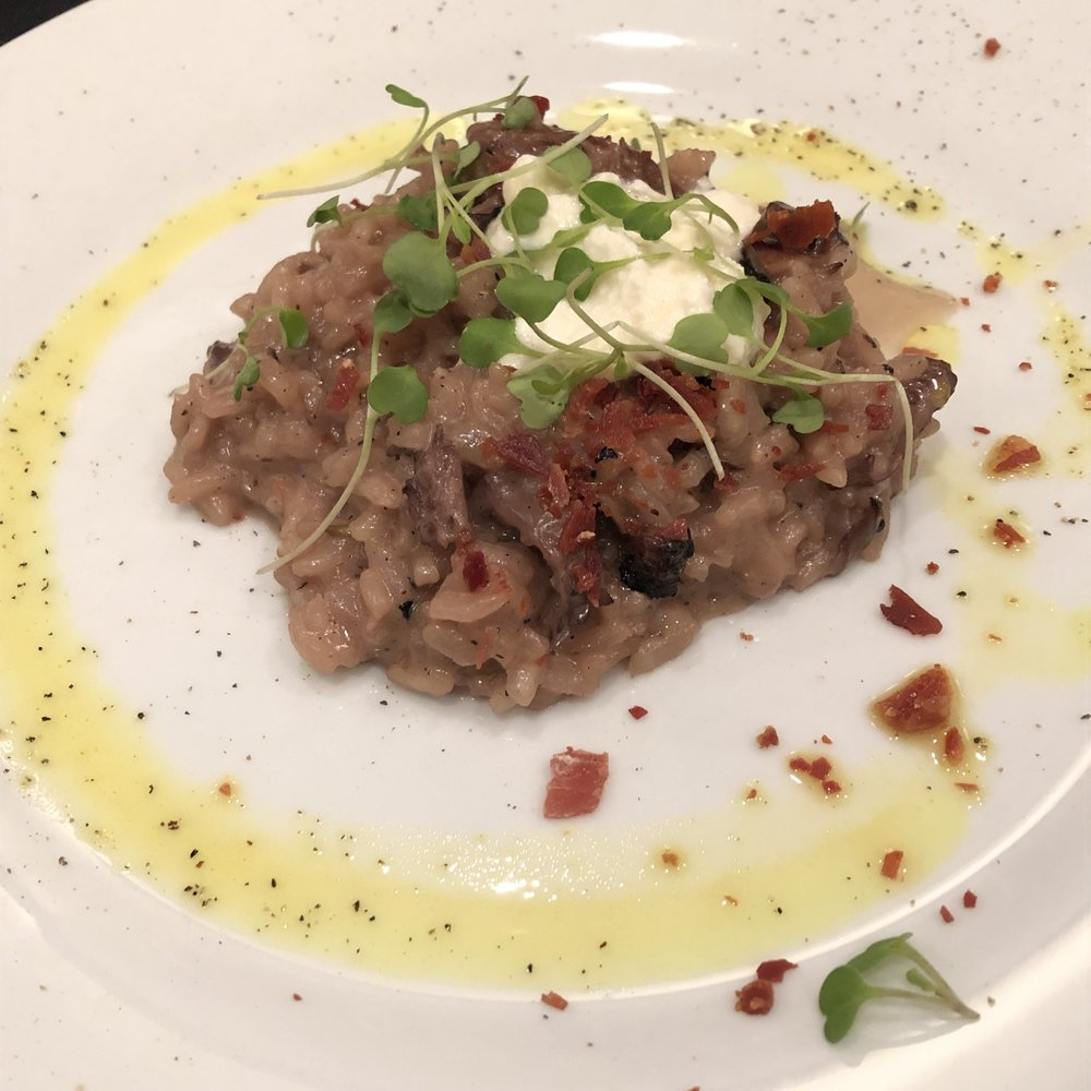 Sangiovese risotto with roasted oyster mushrooms, crispy prosciutto, and robiola cheese.