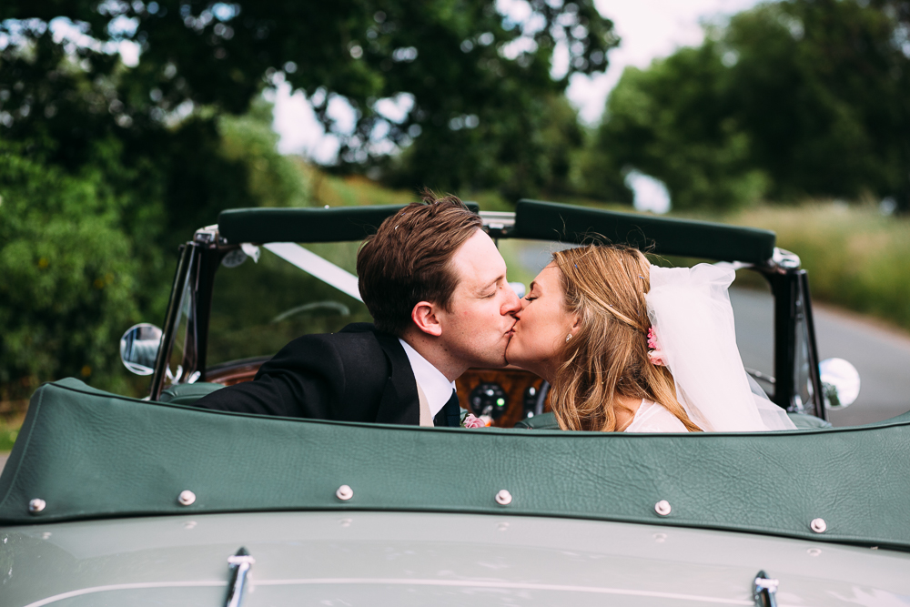 york wedding photographer bride groom kiss car