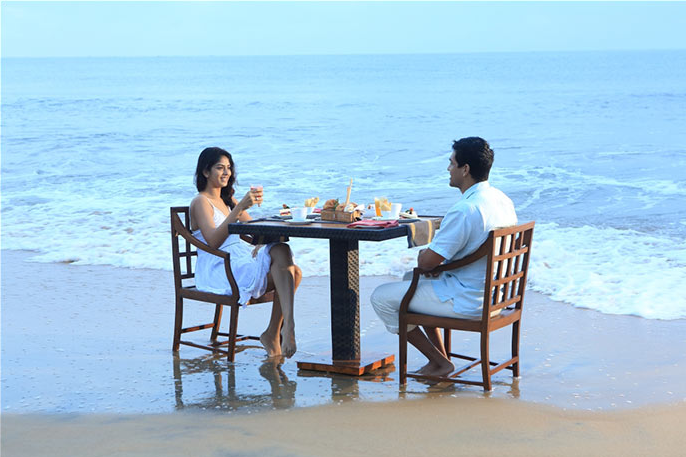 invite-to-paradise-sri-lanka-holiday-honeymoon-vacation-specialists -airport-hotel-negombo-beach-sea-dining on beach.png