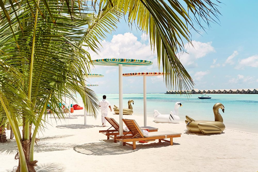 invite-to-paradise-maldives-luxury-holiday-honeymoon-package-specialists-experts-travel-agent-tour-operator-lux-south-ari-atoll-resort-lagoon-bar.jpg