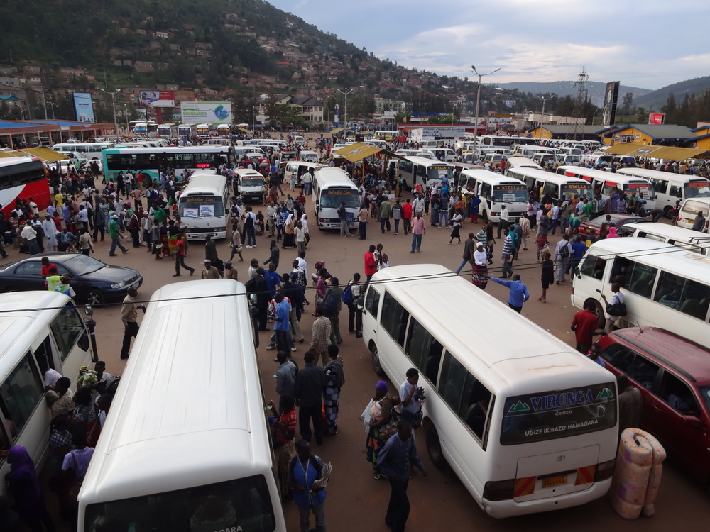 Here's a typical view of Nyabugogo, the main bus station in Kigali, Rwanda. You can see that the space is full of men, and the bustling crowd makes it easy for these men to get away with acts of gender-based violence.Photo credit: Allie Gates