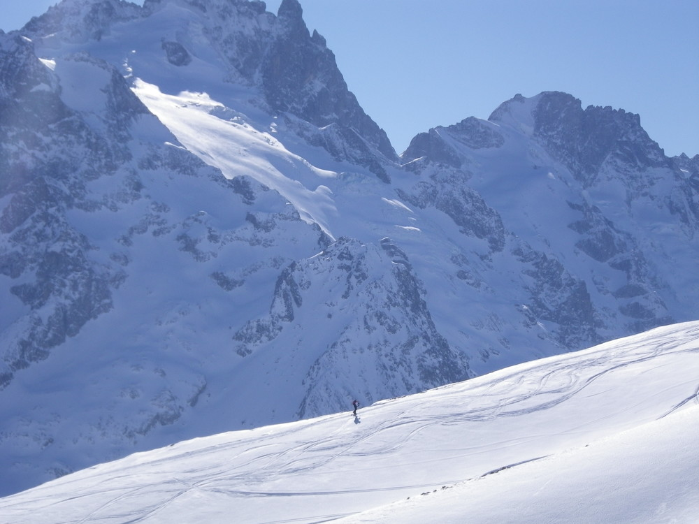Ski touring on the Plateau d'Emparis, with La Meije and Le Rateau behind