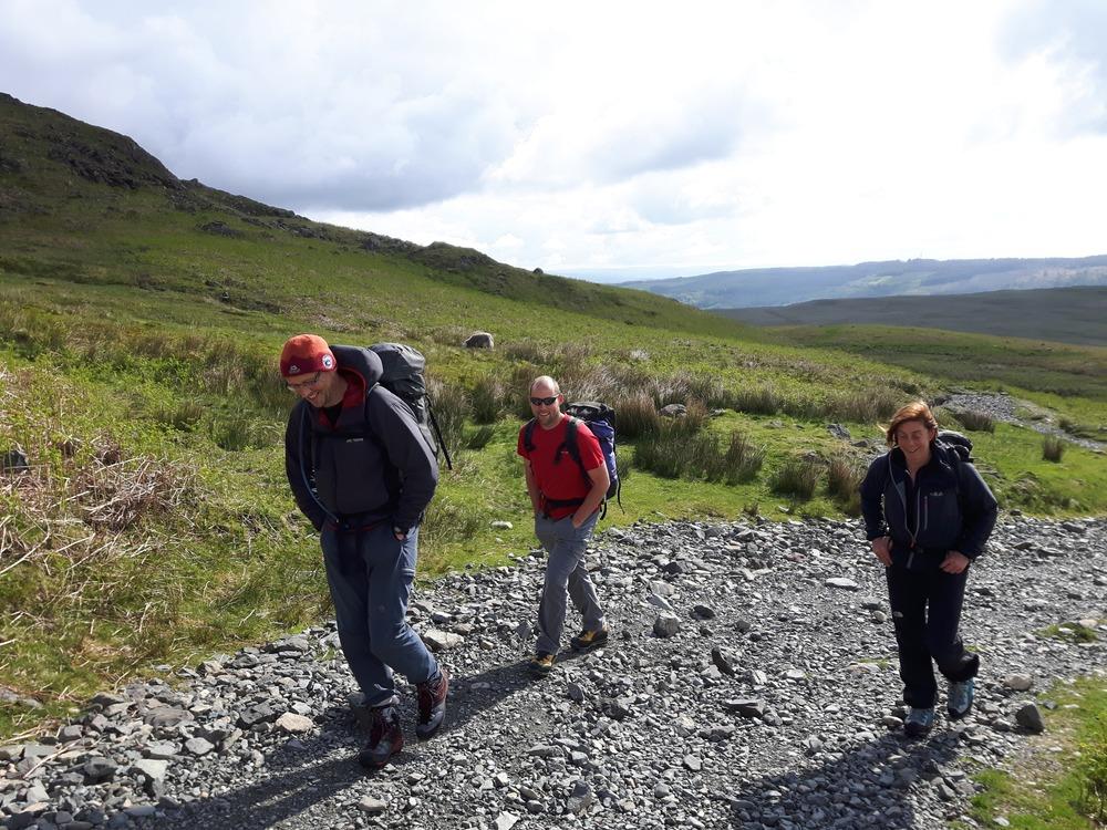 Ian, Dan and Carole walking in on the Walna Scar road