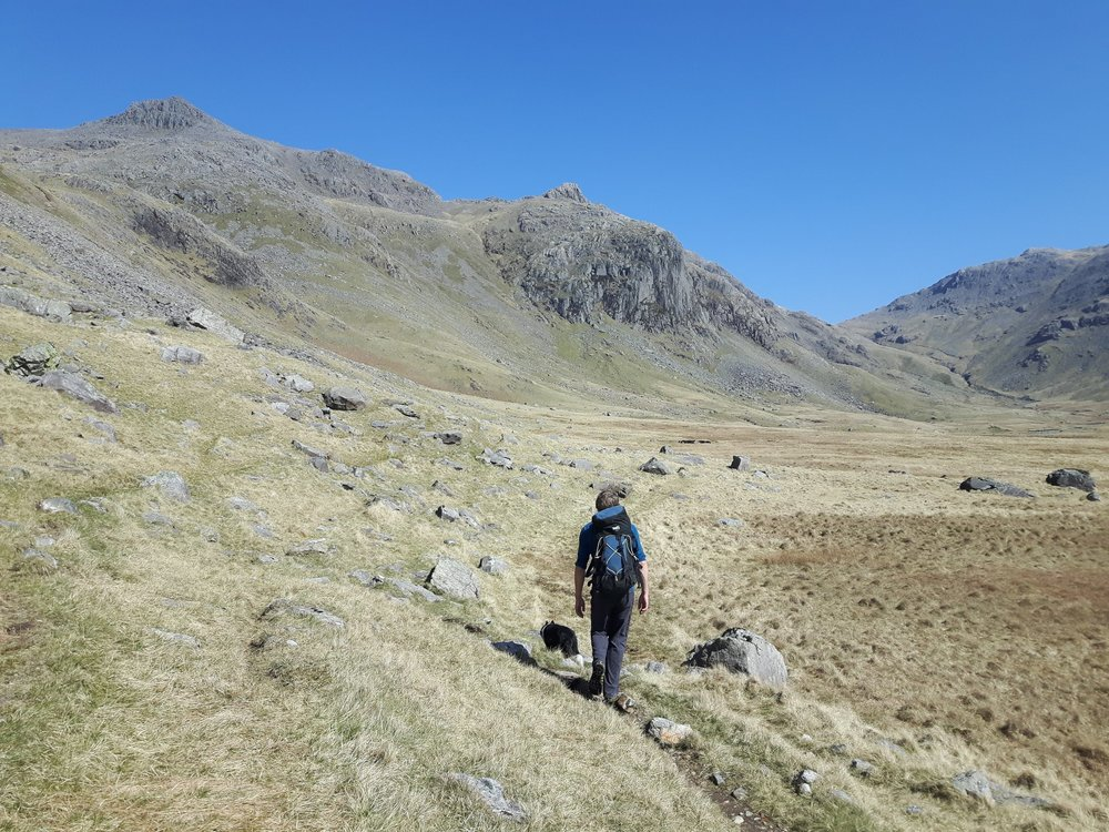 Chris Moore and Pippa walking in to Esk Buttress