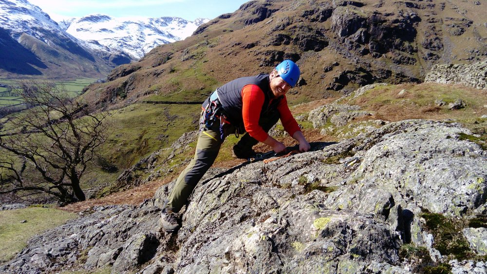 Nathan building an anchor at the top of Stickle Barn crag