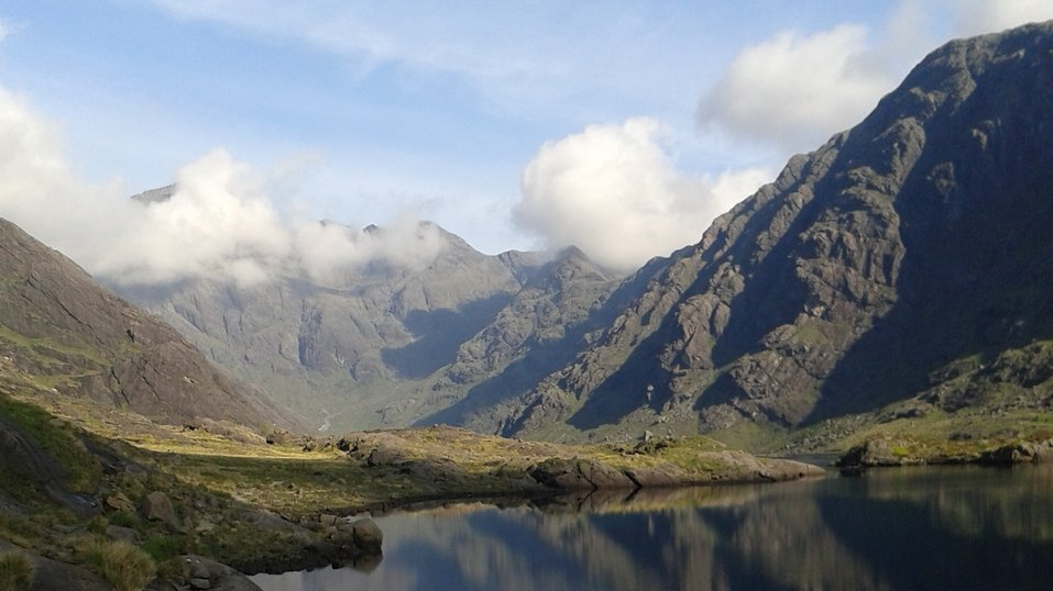 Rocky mountains of the cuillin ridge reflected in water