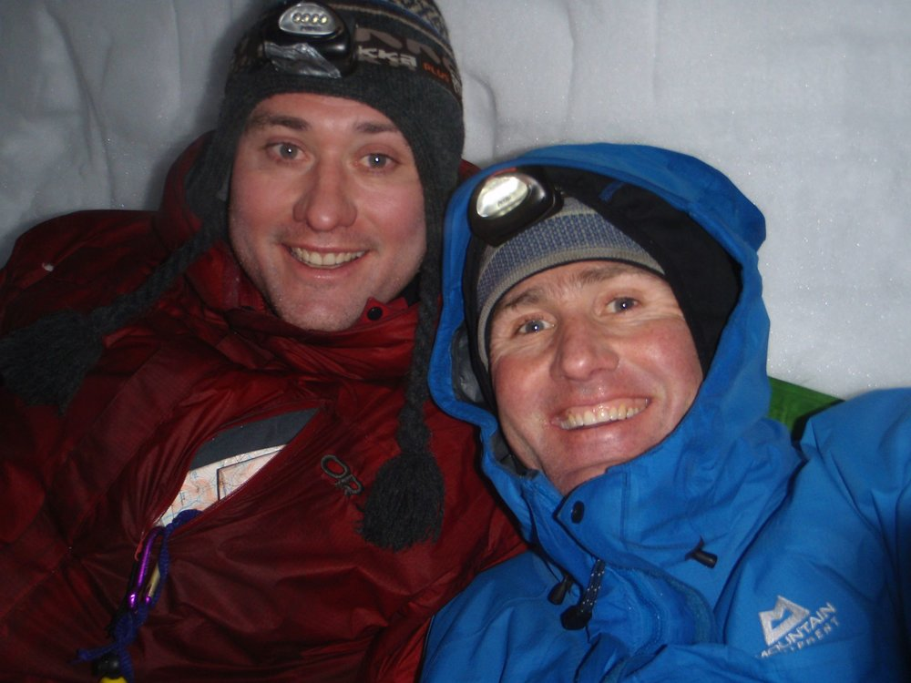 Chris (R) and brother Richard (L) snow-holing in Scotland