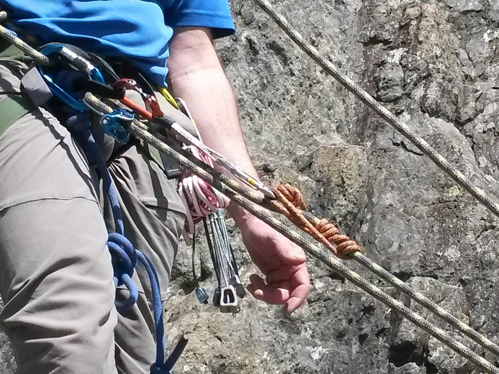 Climbing ropes and karabiners set up for a rescue - Chris Ensoll Mountain Guide