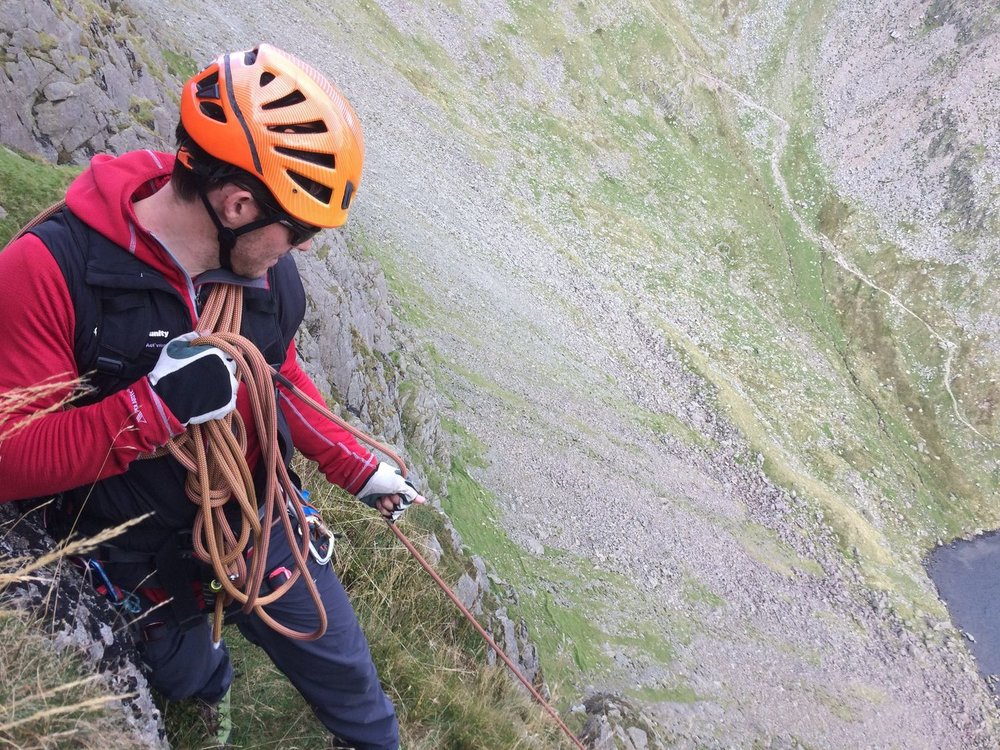 A mountaineer short-roping someone up steep ground - Chris Ensoll Mountain Guide