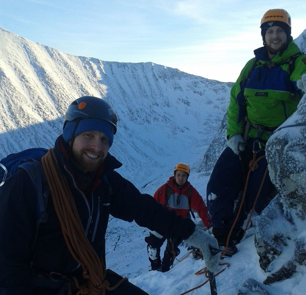 A group of winter mountaineers with coils of rope - Chris Ensoll Mountain Guide