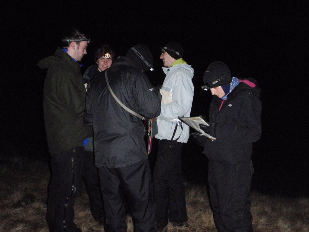 candidates on a mountain leader training course navigating in the dark - chris ensoll mountain guide