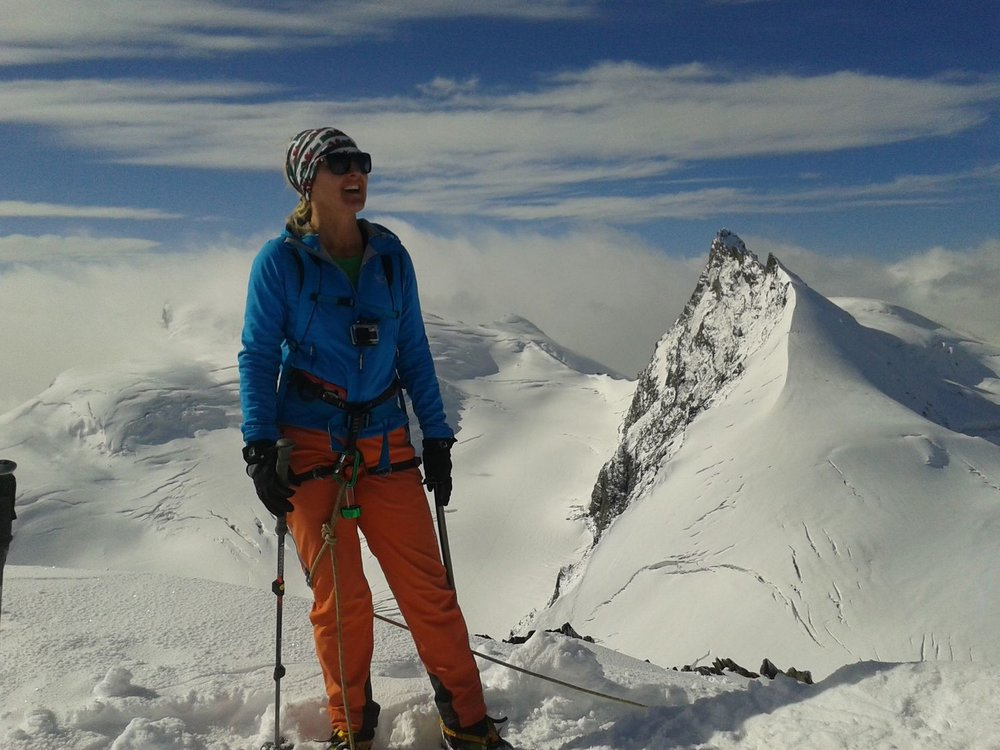 On the summit of the Allalinhorn with the Rimpfischhorn and the Strahlhorn behind