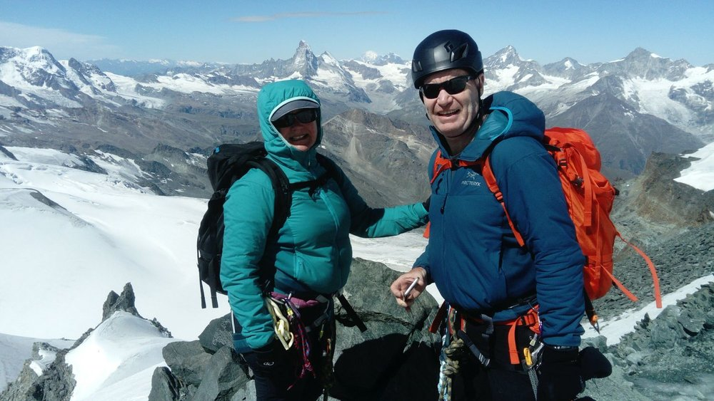 On the summit of the Allalinhorn with the Matterhorn behind