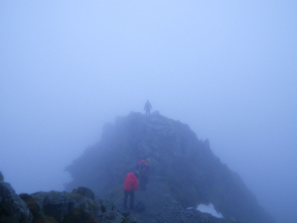 Mountain leader training candidates walking in the mist
