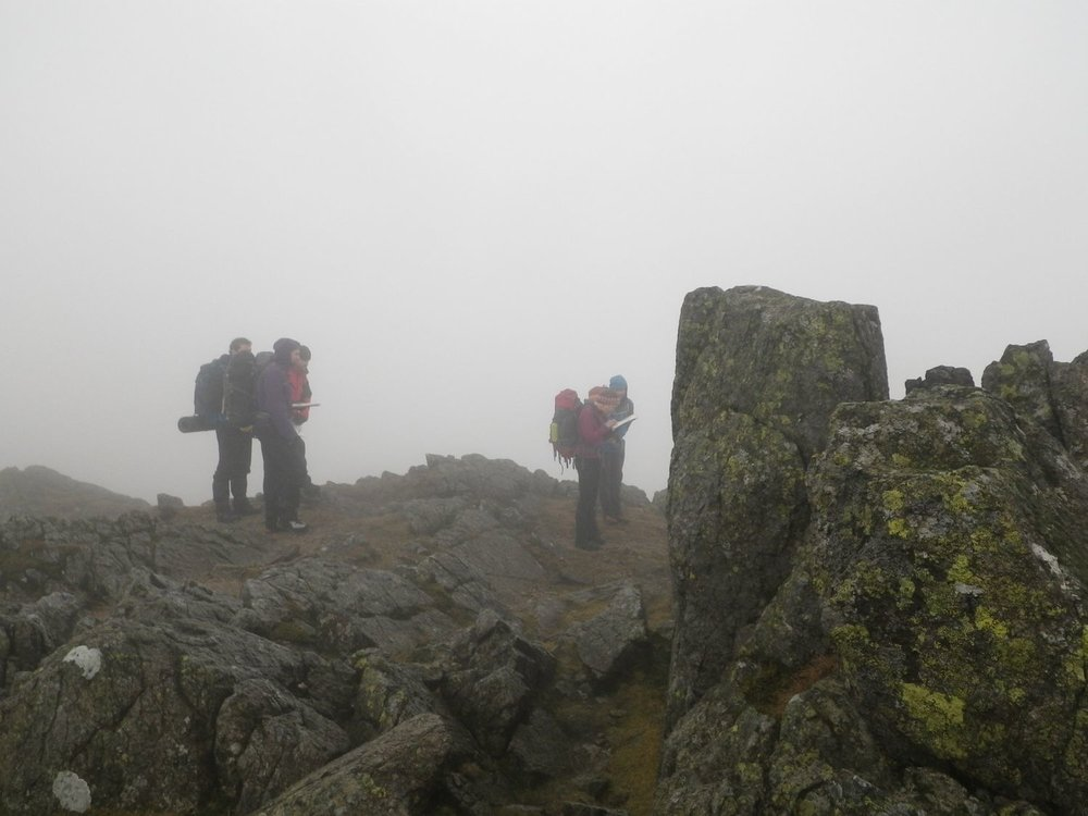 Mountain leader training candidates navigating in the mist