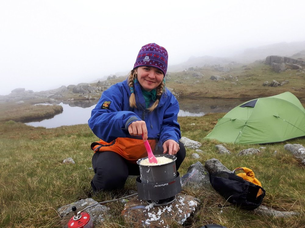 a mountain leader assessment candidate cooking dinner on a wild camp - chris ensoll mountain guide