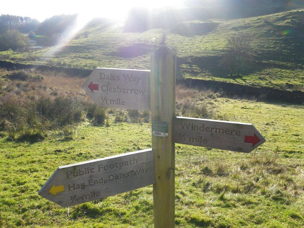 a signpost showing the dales way and public footpaths - chris ensoll mountain guide