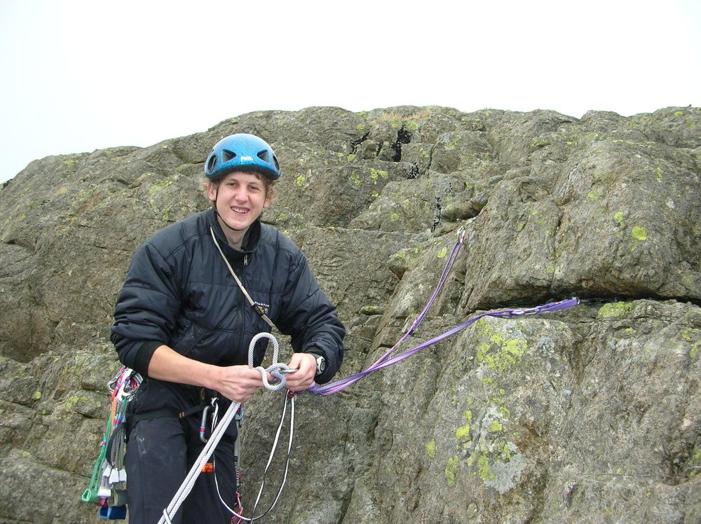 setting up a belay at the top of a route - chris ensoll mountain guide