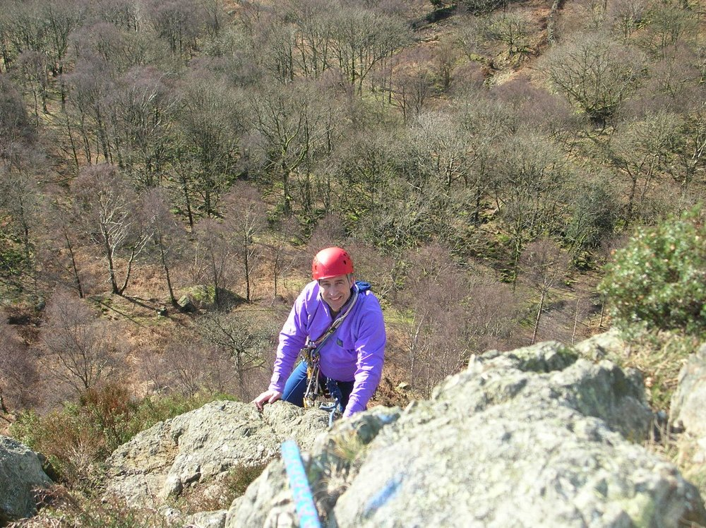 A CLIENT ON A MULTI-PITCH ROCK ROUTE IN THE LAKE DISTRICT - chris ensoll mountain guide