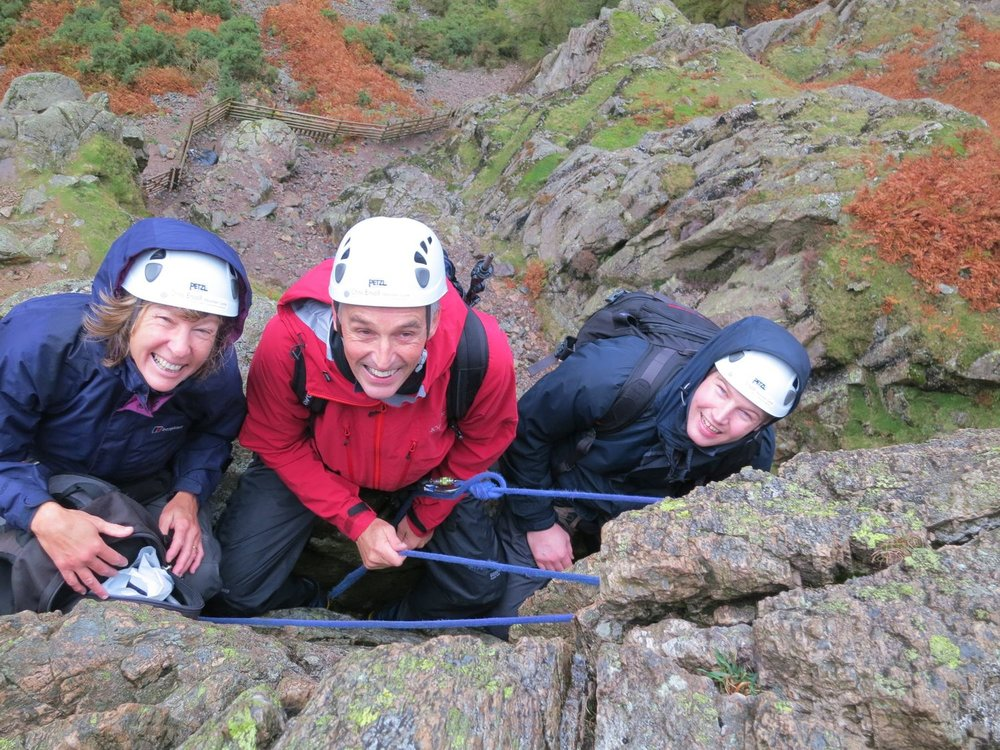 Clients belaying on a single pitch rock route in the Lake District - Chris Ensoll Mountain Guide