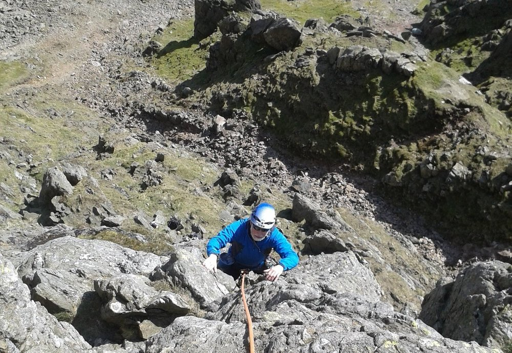 A client on a multi pitch climb in the Lake District - Chris Ensoll Mountain Guide