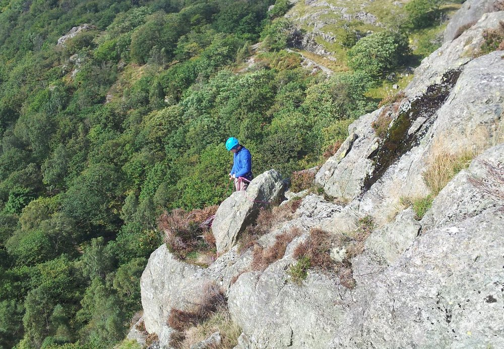 Belaying on a multi pitch climb in the Lake District - Chris Ensoll Mountain Guide