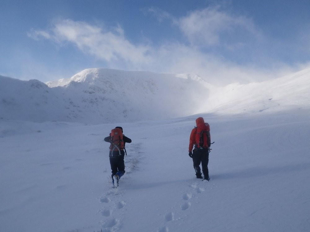 Clients walking in the winter mountains in the Lake District - Chris Ensoll Mountain Guide