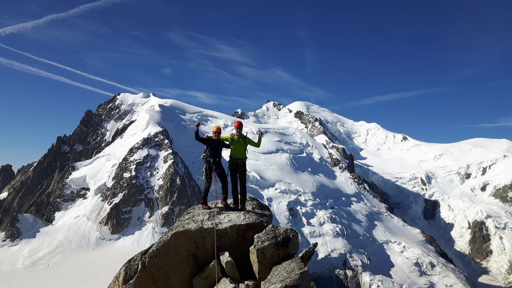 Rob and Ewan on the top of the Cosmiques Arete with Mont Blanc behind