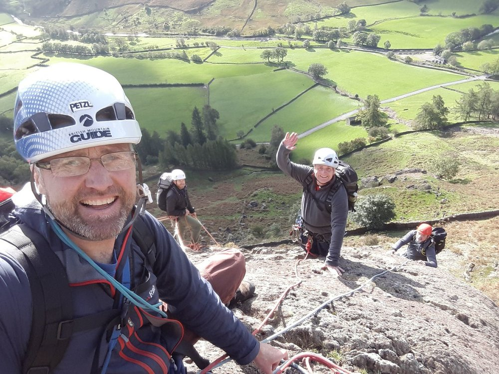 Clients on a multi pitch rock climb in the Lake District - Chris Ensoll Mountain Guide