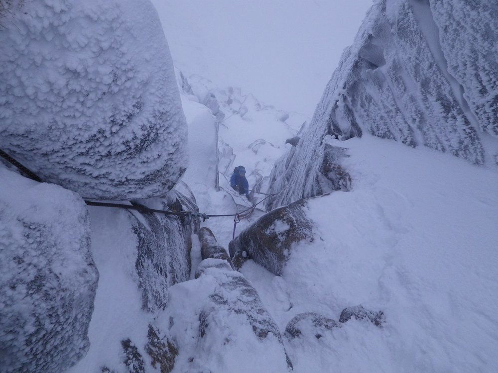 climbing the final pitch of hidden chimney on mess of pottage, coire an t-sneachda
