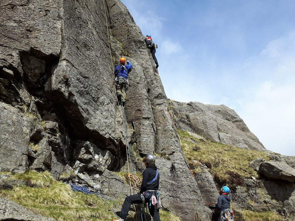 Lead climbing on a Rock Climbing Instructor course - Chris Ensoll Mountain Guide