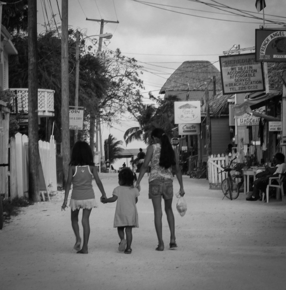 caye caulker kids hand in hand