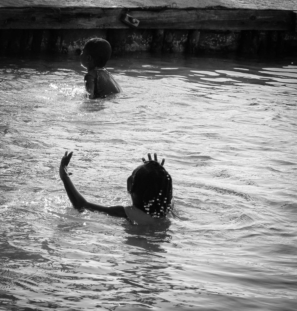 caye caulker kids play in ocean