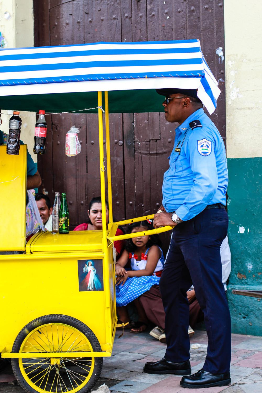 policeman-yellow-food-cart-leon-nicaragua