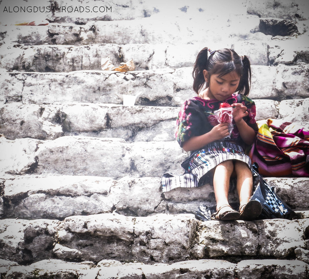 girl on the church steps chichi market guatemala